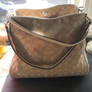 Tan and white Coach purse